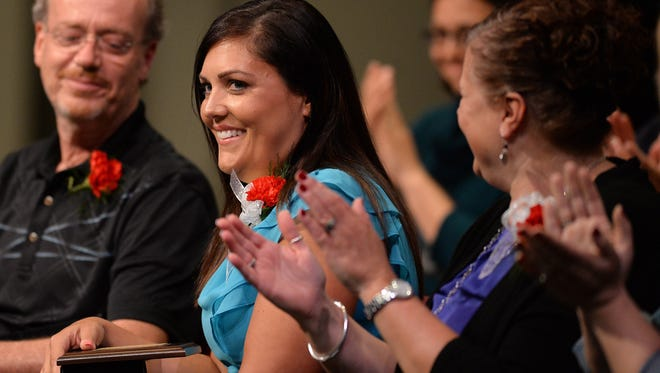 Celeste Johnson reacts as she is named the Richmond Community Schools Teacher of the Year during the 19th Annual Celebration of Excellence ceremony Tuesday, May 3, 2016, in Civic Hall Performing Arts Center at Richmond High School.
