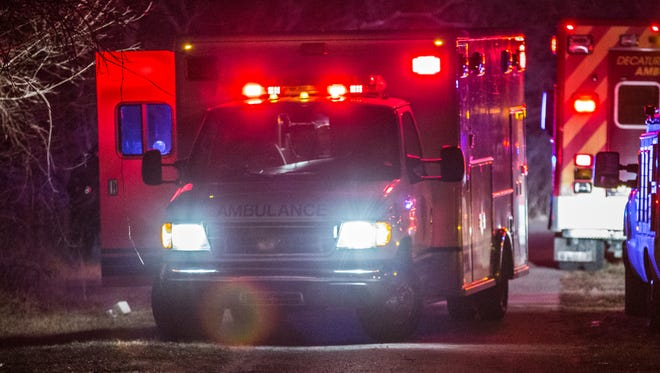 Ambulance prepares to leave the scene of a shooting in the 3400 block of S. Lynhurst Drive with a gunshot victim.