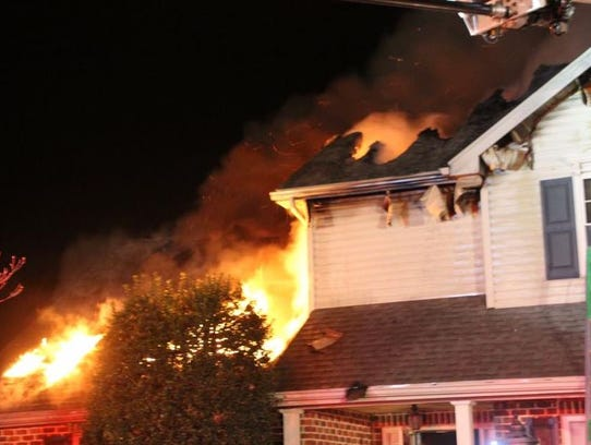 Flames rip through a home on Bell Avenue in Hamilton