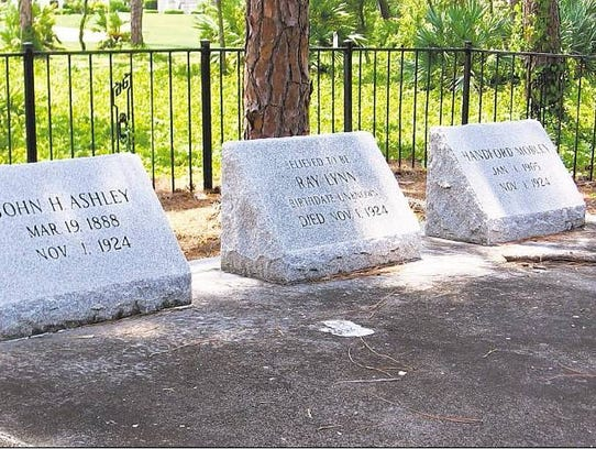 Headstones for John Ashley, Ray Lynn and Hanford Mobley.