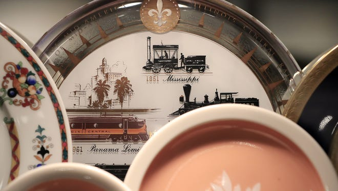 Railroad-themed plates are shown in a display case as part of a new exhibit featuring the Jay W. Christopher Transportation China Collection at the National Railroad Museum in Ashwaubenon. The exhibit opens Saturday.
