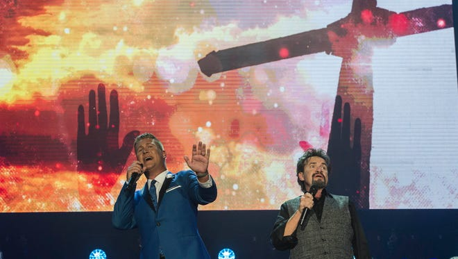 Joseph Habedank and Russ Taff perform at the 46th Annual GMA Dove Awards on Tuesday Oct. 13, 2015, in Nashville in Tenn.