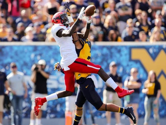 Texas Tech receiver T.J. Vasher makes a 53-yard touchdown catch with West Virginia safety Kenny Robinson defending Saturday in Morgantown, West Virginia. Vasher, a Rider grad, had a breakout performance, catching two passes for 113 yards and two touchdowns.