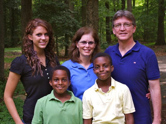 Lori and Glen Rowe with three of their children. Among the reasons the Rowes chose the Dominican Republic was so Micah, nearly 14, and Isaiah, nearly 13, could attend a school where most of the classes are taught in English. They also play basketball in different leagues.