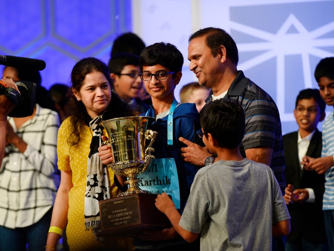 Karthik Nemmani is greeted by his family after he won