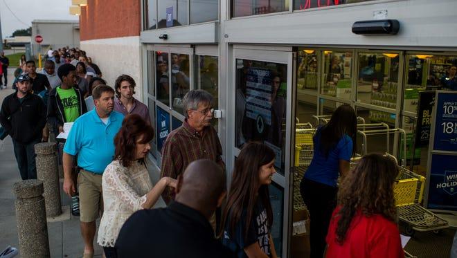 Shoppers file Best Buy for Black Friday sales in Lafayette, La., Thursday, Nov. 26, 2015.