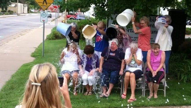 Members of the Lincoln Center Seniorobics class at the Aging & Disability Resource Center of Portage County completed the ALS Ice Bucket Challenge Aug. 26. The activity was performed in honor of Romel Cooney, a former Seniorobics class instructor who was present at the event, and others who have ALS.