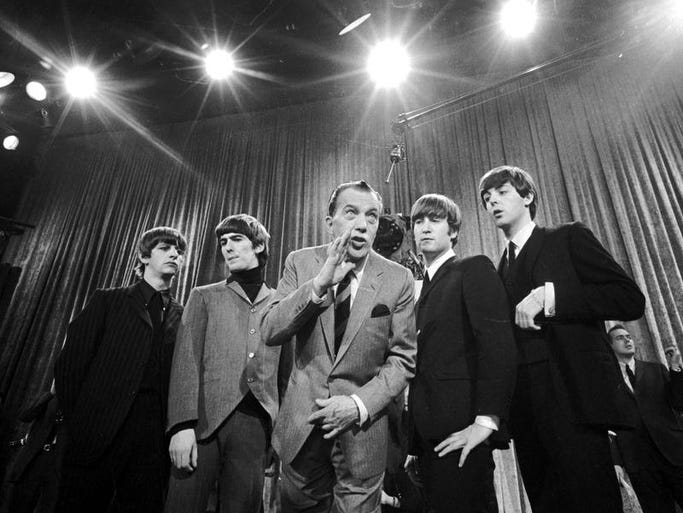 "Ed Sullivan, center, stands with The Beatles during a rehearsal for the British rock band's first American appearance, on ""The Ed Sullivan Show"" in New York on Feb. 9, 1964. From left: Ringo Starr, George Harrison, Sullivan, John Lennon and Paul McCartney. It was the rock 'n' roll band's U.S. debut and kicked off Beatlemania in America."