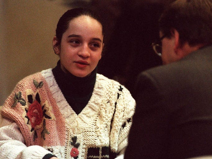 Kristina Fetters, on trial in the 1994 slaying of Arlene Louis Klehm, talks with her attorney, William Price, right, during opening of her trial on Tuesday, Dec. 12, 1995.
