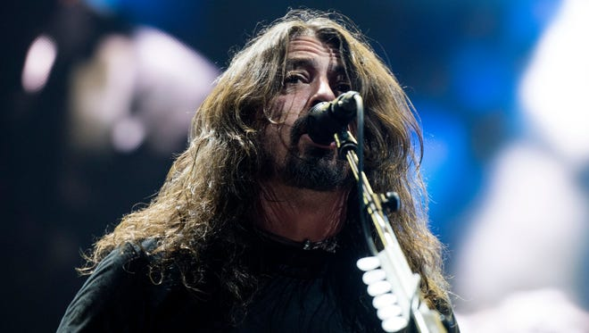 Foo Fighters lead singer and guitarist Dave Grohl performs during the band's show at the Denny Sanford Premier Center in Sioux Falls, S.D. on Saturday, Nov. 11, 2017.