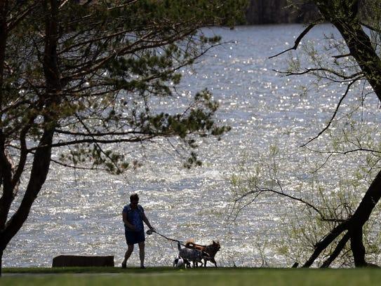 Louiose Becklund, Kaukauna, walks her dogs Monday on