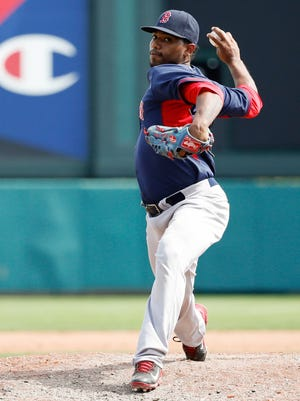 Boston Red Sox pitcher Dayan Diaz delivers a pitch during the game against the Atlanta Braves at Champion Stadium in March of 2014.