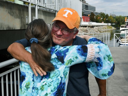 Michael Rogers hugs his sister Crystal Walker after