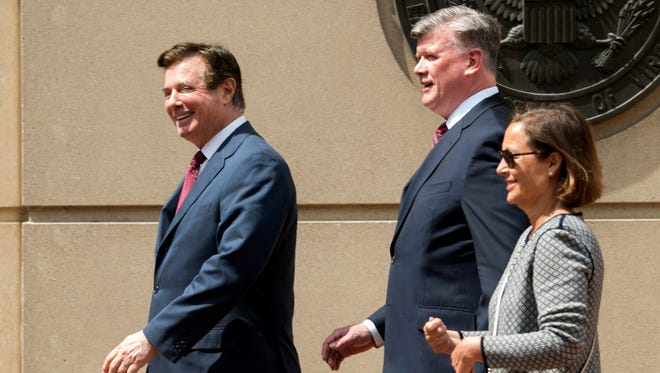 Paul Manafort, left, leaves the Alexandria Federal Courthouse with his attorney Kevin Downing, center, on Friday, May 4, 2018, in Alexandria, Va.