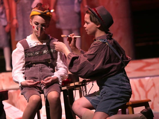 Naomi Schag, 11, plays Pinocchio while Cooper Sanders, 12, portrays Geppetto during a rehearsal of the Renaissance Youth Opera Theatre production of Pinocchio on Thursday night.