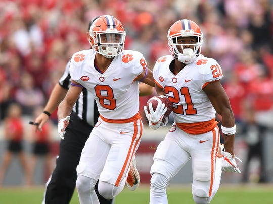 Clemson wide receiver Ray-Ray McCloud (21) returns an NC State punt 77 yards to score a TD during the 1st quarter on Saturday, Nov. 28, 2017 at Clemson's Memorial Stadium.