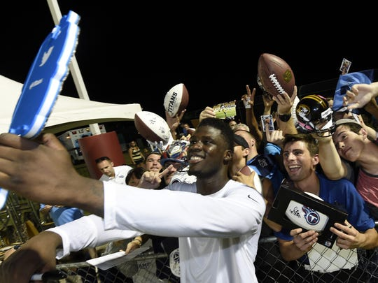 Dorial Green-Beckham takes a selfie with fans after a training camp session last season.