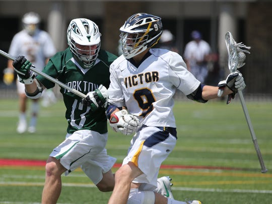 Victor #9 Andrew Russell and Yorktown defender, #13, Jose Boyer at State Championships.