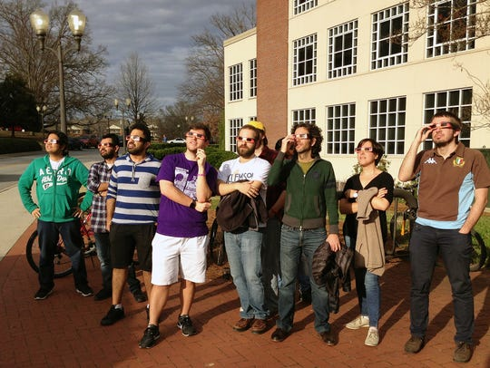 A group of Clemson astronomers and students trying