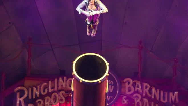 This image released by Feld Entertainment shows Gemma Kirby, the 25-year-old human cannonball during a performance at Circus Xtreme where she hurtles out of a cannon at up to 66 mph and lands up to 104 feet away in an air bag. Kirby will be celebrating a special milestone on Saturday: She's expected to notch her 500th total flight in Philadelphia. (AP Photo/Feld Entertainment)