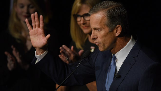 U.S. Senator John Thune delivers his acceptance speech while his wife, Kimberley, listens during the Minnehaha GOP Republican election party at  The District in Sioux Falls.