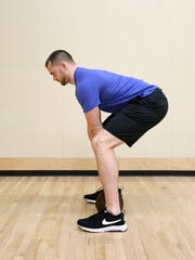 Kyle Davey, head trainer at Courthouse in South Salem, demonstrates a deadlift.