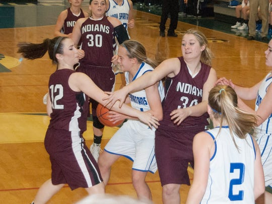 Kellyn Perry of McConnellsburg, center, grabs a loose