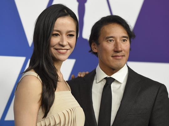 Elizabeth Chai Vasarhelyi, left, and Jimmy Chin arrive