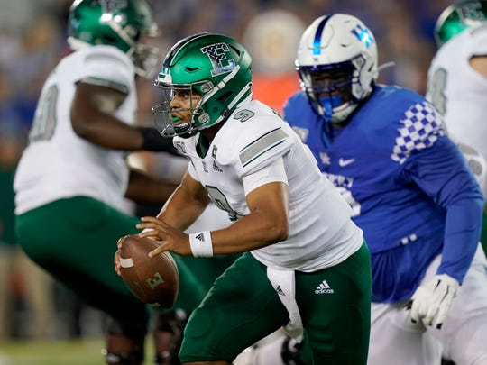 Eastern Michigan quarterback Mike Glass III scrambles with the ball against Kentucky, Sept. 7, 2019.