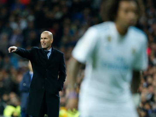 Real Madrid's head coach Zinedine Zidane gives instructions from the sideline during the Spanish La Liga soccer match between Real Madrid and Las Palmas at the Santiago Bernabeu stadium in Madrid, Sunday, Nov. 5, 2017. Real Madrid won 3-0. (AP Photo/Francisco Seco)