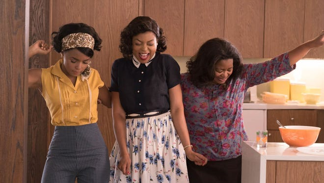 Mary Jackson (Janelle Monae, left), Katherine Johnson (Taraji P. Henson) and Dorothy Vaughan (Octavia Spencer) take time to dance in the period drama 'Hidden Figures.'