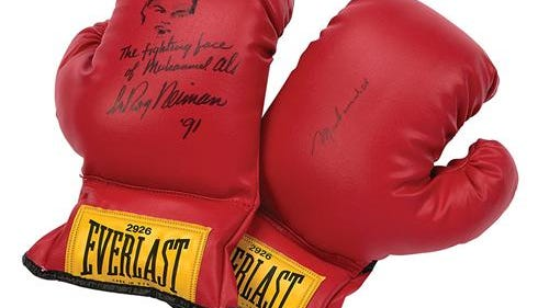 A pair of Ali signed gloves up for auction.
