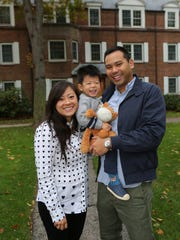 Stefanie and Jonathan Lew stand with their son Owen, 2, outside their co-op in Hastings Oct. 24.