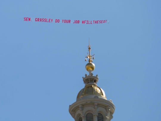 A banner flown over  the Iowa Statehouse on Monday,
