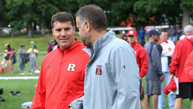 Rutgers coach Chris Ash and Temple coach Matt Rhule chat at the Rutgers Football Tri-State Showcase.