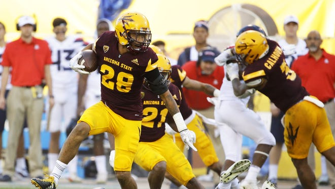 Arizona State defensive back Demonte King intercepts an Arizona pass in the second half on Nov. 25, 2017 during the 91st Annual Territorial Cup in Tempe, Ariz.
