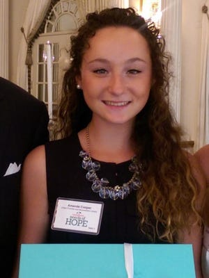 Moorestown Friends student Amanda Cooper was honored for creating a book club for girls at Moorestown Library.