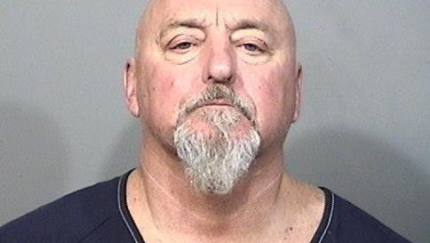William Lewis, 52, was charged with felony battery after police say he pushed his girlfriend from a balcony.