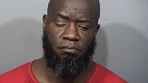 Joseph Brown, 48, was one of two suspects arrested for murder after a Titusville shooting.