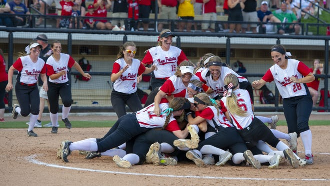 The New Palestine High School team celebrates after winning the 34th Annual IHSAA Softball State Finals class 3A game, Saturday, June 9, 2018, at Bittinger Stadium on the campus of Purdue University, West Lafayette. New Palestine High School won over South Bend St. Joseph High School 3-1.