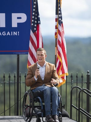 Madison Cawthorn, Republican candidate for the NC-11 congressional seat, introduces Donald Trump Jr. during a presidential campaign event at Point Lookout Vineyards in Hendersonville on Sept. 10.