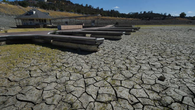 Boat docks sit empty on dry land, as Folsom Lake reservoir near Sacramento stands at only 18% capacity, as the severe drought continues in California on Sept. 17, 2015.