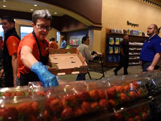 Susie Ward of Morris Plains restocks strawberries at