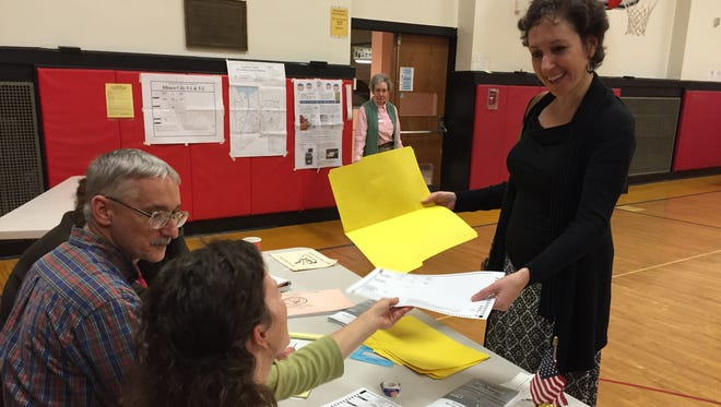 Fall Creek voter Lesley Greene gets her ballot