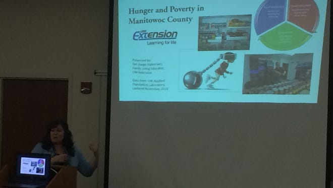 Teri Zuege-Halvorsen gives a presentation on hunger and poverty in Manitowoc County.