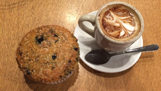 A blueberry cornbread muffin ($2.25) and an espresso macchiato ($2.35) from the southwest Iowa City Java House.