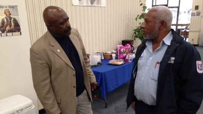 Harrell Carter (left) talks with Curtis Harden of the Jackson Transit Authority Tuesday at the Jackson-Madison County NAACP Branch offices.  Carter was elected to a sixth term as branch president.