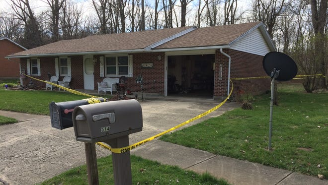 Crime tape on Wednesday surrounded the home at 514 Cardinal Hill Drive in New Paris, Ohio.