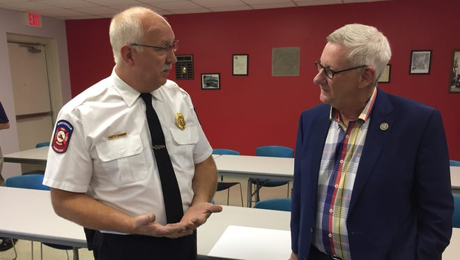 Burtchville Fire Chief Mark Harrington, left, talks with U.S. Rep. Paul Mitchell during a grant presentation on Friday, Aug. 25, 2017. Burtchville received a federal grant to buy a water tender.