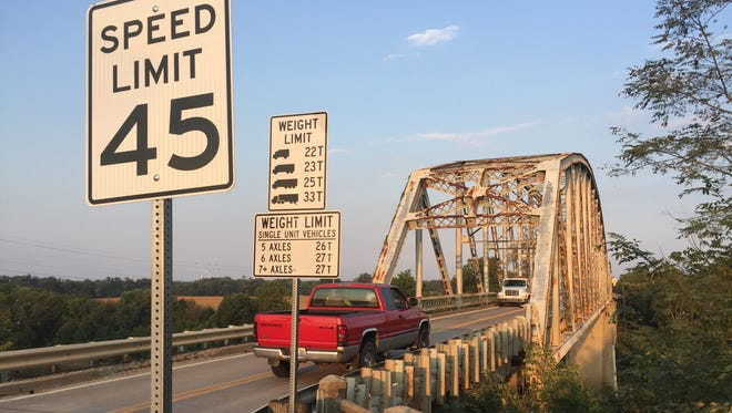 Two semi trucks barely fit on the badly outdated Spottsville Bridge, built in 1930. But it is being replaced to bring it up to modern standards.